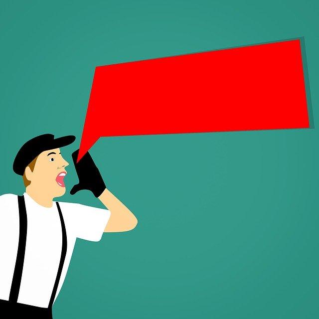 kreslený muž něco oznamuje v červeném dialogovém okně